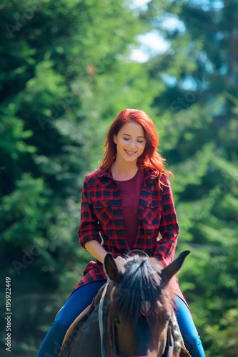 Redehad girl with horse in the forest
