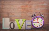 Retro alarm clock and text love