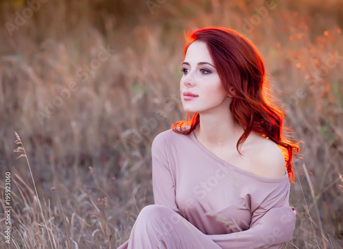 Redhead girl in style clothes