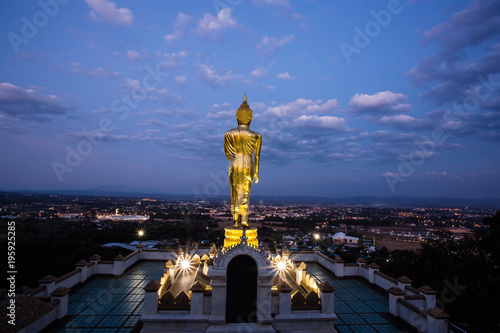 Plexiglas Boeddha Buddha standing on a mountain at Wat Phra That Kao Noi with sunrise. Nan, THAILAND.