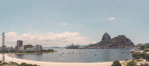 Keuken foto achterwand Rio de Janeiro Panoramic view of Rio de Janeiro from a high point: Botafogo district with bay, multiple yachts in the water, Sugarloaf mountain with its cableway, hotels and residential houses in the distance