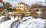 The famous Trinity Bridge, with the Ulzama River as it passes through Atarrabia, Navarra, Spain - 195934484