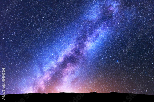 mata magnetyczna Milky Way. Space. Scenic night landscape with bright milky way, sky full of stars, orange light and hills. Shiny stars. Beautiful scene with universe. Space background with starry sky. Concept. Nature