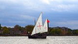 Retro style wooden tall ship carrying flag of Portugal sailing on river Thames in London, UK - 195940839