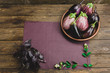 Fresh eggplant on a wooden background
