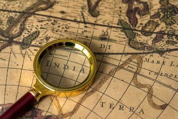 Retro magnifier with old map