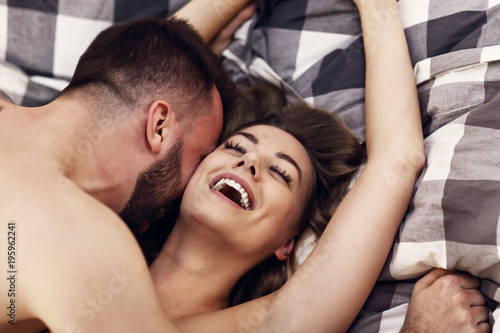 Sexy young lovers being intimate in bed - 195962241
