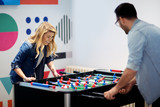 Friends having fun together playing table football - 195967212