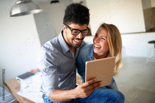 Happy couple in love surfing on tablet
