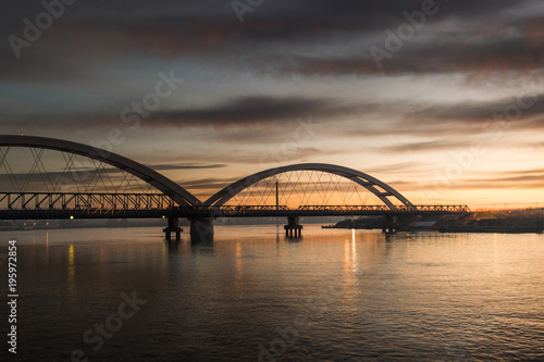 Poster Panorama photo view at sunrise of the city bridge and the river