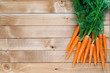 Carrot vegetable with leaves on the wooden background. - 195977644