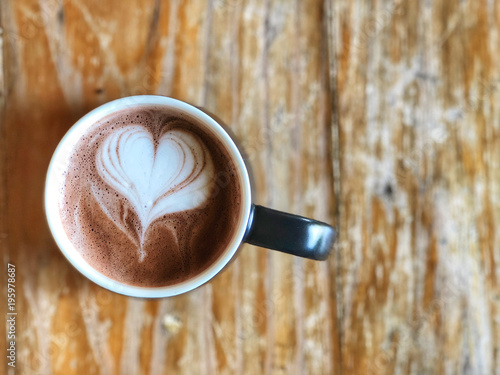 Fotobehang Chocolade Hot cocoa cup on the wooden table, top view and copy space, Heart love shape latte art . love and romantic
