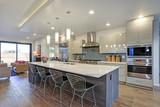 Sleek modern kitchen design with a kitchen peninsula - 195980845