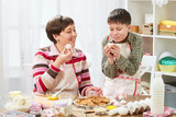 Mother and son cooking at home. Healthy food concept - 195982247