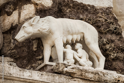 Tuinposter Rome The founding of Rome. Capitoline she-wolf feeding Romulus and Remus sculpture in Piazza del Popolo (People's Square) in Rome, made by italian artist Ceccarini in 1823