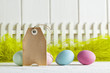 Happy Easter - Blank paper label and colored eggs on green and white background