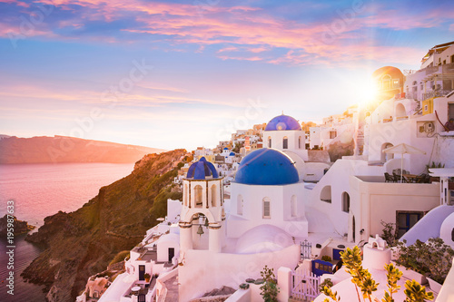 Fotobehang Natuur Sunset view of the blue dome churches of Santorini, Greece.