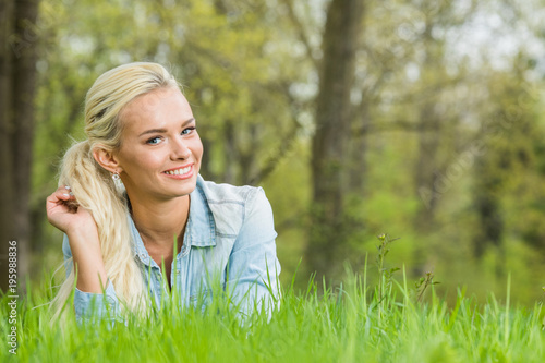 Woman laying on green grass