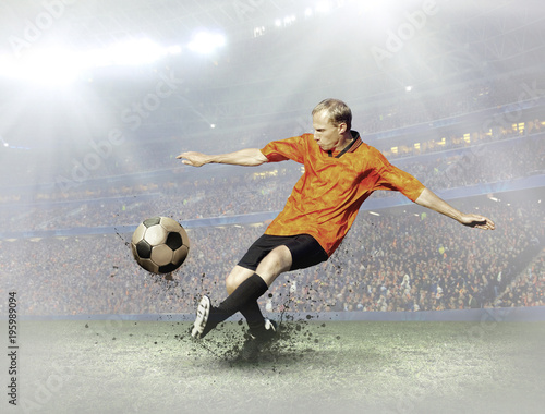 Fotobehang Voetbal Soccer player with ball in action on field of stadium