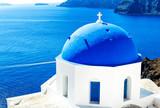 Wonderful White and Blue Greek church against blue Aegean Sea in Santorini (Oia), Greek Islands, Greece - 195993831