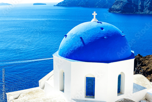 Aluminium Santorini Wonderful White and Blue Greek church against blue Aegean Sea in Santorini (Oia), Greek Islands, Greece