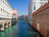stunning view on a bright waterway with beautiful buildings that leads into the Grand Canal in Venice, Italy