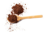 Cocoa powder pile in wooden spoon isolated on white background - 195998436