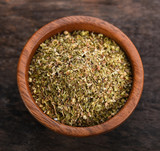 Oregano dry in bowl on wooden background - 196000643