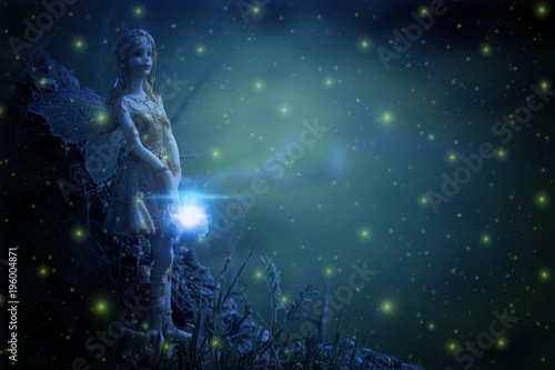 image of magical little fairy in the night forest.