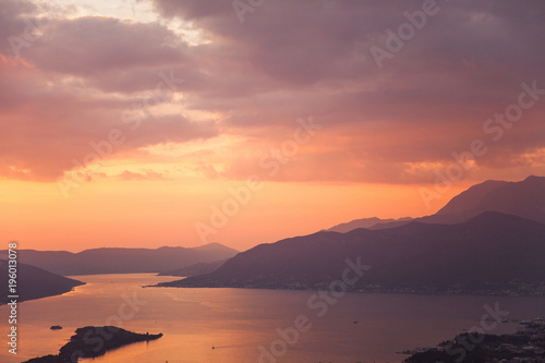 Foto op Plexiglas Koraal Amazing sunset landscape with sea, mountains, colorful pink, orange and purple cloudy sky. Beautiful The Boka Kotor Bay and Tivat view in Montenegro. Nature background.