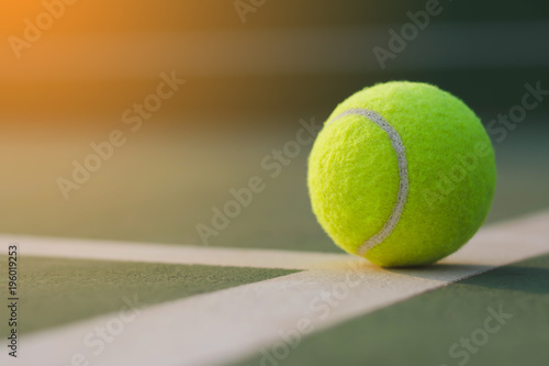 Fototapeta Close up tennis ball on the courts background