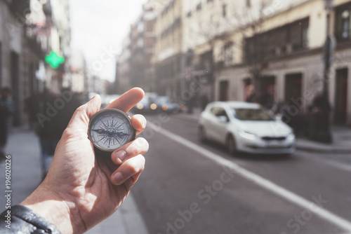 Deurstickers Madrid Hand of person holding compass in Madrid city