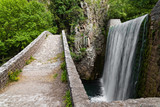 Traditional stone bridge and waterfall near Paleokaria village in Thessaly, Greece - 196024069