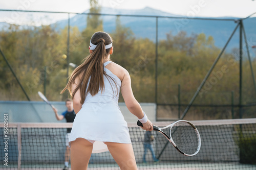 Aluminium Tennis Woman waiting for return playing tennis with her partner