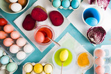 Dyeing eggs for Easter holidays, coloring with different red  color and tonality using food colorant over a gray concrete background - 196038097