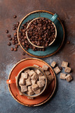 Coffee cups with beans and sugar