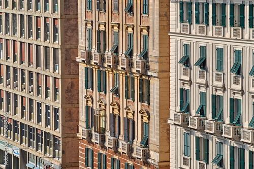Aluminium Liguria Three buildings with a similar pattern made of windows, balconies and window shutters in the street of Genoa, Italy