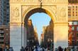 People in Washington Square Park at sunset with view of Midtown skyline in New York City - 196052278