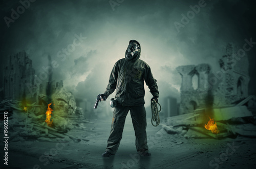 After catastrophe men coming in gas mask and arms Poster