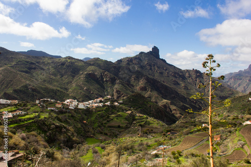 Papiers peints Iles Canaries Great panoramic views of Roque Bentayga mountain from Tejeda town in Gran Canaria, Spain. Old town valley with iconic mountain on background on sunny day