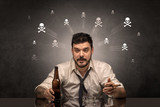 Drunk man sitting at table with skulls concept - 196053206