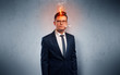 Sick businessman with burning head concept
