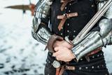 man warrior with iron sword - 196058881
