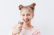 Quadro Portrait of a charming girl with ice cream on a white background.