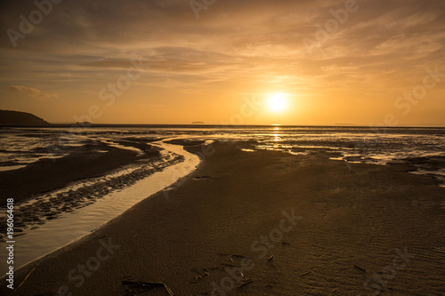 Fotobehang Strand Beautiful sunset sky on the Somerset coast in England
