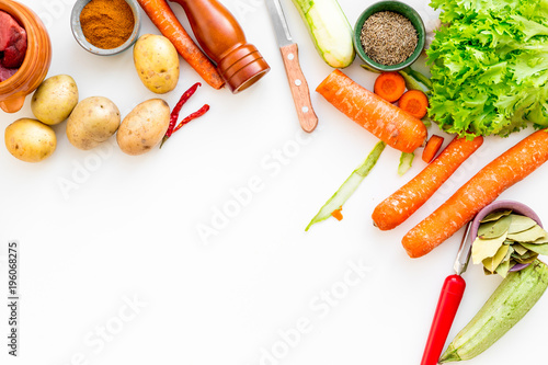 cut vegetables for cooking ragout or ratatouille for healthy dinner white background top view space for text