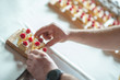 pieces of cheesecake with hands, confectioner hands at work