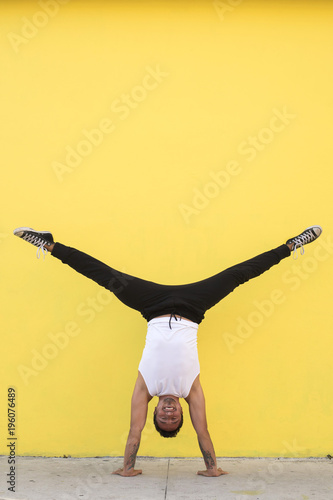 Fototapeta Mexican yoga teacher practices in a colorful background
