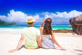 Young couple having fun at tropical Baie Lazare beach at Mahe island, Seychelles - 196077641