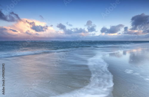 Fotobehang Noordzee blurred wave on north sea coast